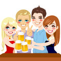 Young friends beer toast two couple making a with on a party celebration Royalty Free Stock Photos