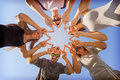 Young friends having fun at sunny day friendship and summer holidays concept group of teenagers looking down placed in a circle Royalty Free Stock Photos
