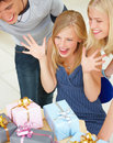 Young friends looking at gifts Stock Photography