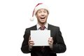 Young funny businessman in santa hat holding sign Stock Images