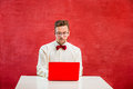 Young funny man with laptop at St. Valentine`s Day Royalty Free Stock Photo