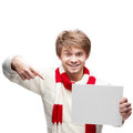Young funny man pointing at sign portrait of cheerful caucasian which with nice smile Royalty Free Stock Image