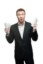 Young funny screaming businessman holding money Stock Photo
