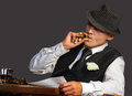 Young gangster with hat smoking cigar studio shot Royalty Free Stock Photo