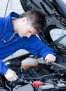 Young garage owner repairing a motor Stock Images
