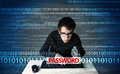 Young geek hacker stealing password on futuristic background Stock Photo