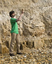 Young geologist studying rock type Stock Photos