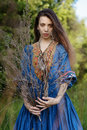 Young gipsy in the forest blue dress at Stock Images