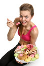 Young girl athletic physique eating cupcake and is not afraid of getting fat photo set of sporty muscular female brunette Royalty Free Stock Photography