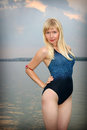 Young girl in athletic swimsuit lovely on beach Royalty Free Stock Image