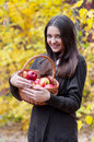 Young girl in autumn park with a basket of apples beautifulgirl Stock Photo