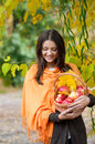 Young girl in autumn park with a basket of apples beautifulgirl Royalty Free Stock Photos