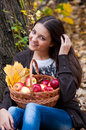 Young girl in autumn park with a basket of apples beautifulgirl Stock Image