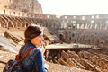 Young girl with backpack exploring inside the Coliseum Royalty Free Stock Photo