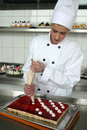Young girl baking cakes Royalty Free Stock Images