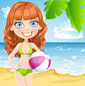 Young girl in a bathing suit with an inflatable ball on sunny beach Stock Image