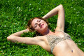 The young girl in a bathing suit sunbathes Royalty Free Stock Photos