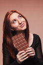 Young girl with the big chocolate portrait of Stock Photo