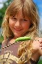 Young girl with big green caterpillar Royalty Free Stock Photos