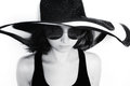 Young girl in a big round sunglasses and summer hat Royalty Free Stock Photo