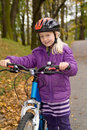 Young girl with a bike Royalty Free Stock Images