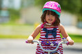 Young girl on bike riding a bicycle safely Royalty Free Stock Photography
