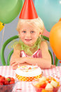 Young girl with birthday cake at party Stock Photo
