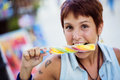 Young girl bitting an ice lolly Royalty Free Stock Images