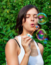Young girl blowing soap bubbles Stock Photography