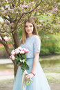 Young girl with a bouquet of peonies in the park, garden. Summer, spring Royalty Free Stock Photo