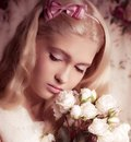Young girl with bouquet from roses on background Stock Photo