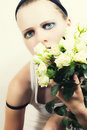 Young girl with a bouquet of white roses Stock Images
