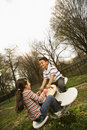 Young Girl and Boy Playing on Seesaw Royalty Free Stock Photos