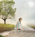Young Girl at a Brook Stock Photography