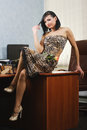 Young girl brown dress sitting office table Royalty Free Stock Photos
