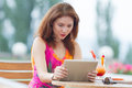 Young girl browsing trendy tablet pc attractive red haired woman playing with her Royalty Free Stock Photography