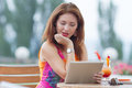 Young girl browsing trendy tablet pc attractive red haired woman playing with her Stock Image
