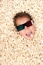 Young girl buried in popcorn Stock Photos