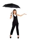 Young girl in a business suit and carrying an umbrella his hand on white background Stock Photos