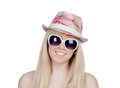Young girl with a cap and sunglasses isolated on over white background Royalty Free Stock Image