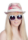 Young girl with a cap and sunglasses isolated on over white background Stock Photos