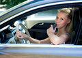 Young girl in car with car key Royalty Free Stock Photo