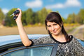 Young girl with car key in hand beautiful Royalty Free Stock Images