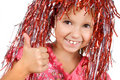 Young girl with carnival wig showing thumb up Stock Images