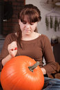Young girl carving a pumpking Stock Photography