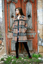 Young girl in checkered coat Royalty Free Stock Images