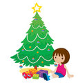 Young girl by a christmas tree Royalty Free Stock Image