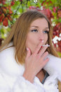The young girl with a cigaret Royalty Free Stock Photo