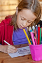 Young girl colouring close up of vertical image Stock Photo
