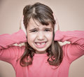 Young girl covering her ears